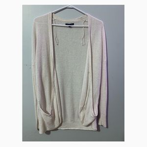 Very light pink in colour cardigan